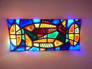 Photo: Steve Cadman, Creative Commons. Stained glass by Helen Moloney in St Michael's Creeslough (1971) by Liam McCormick, County Donegal