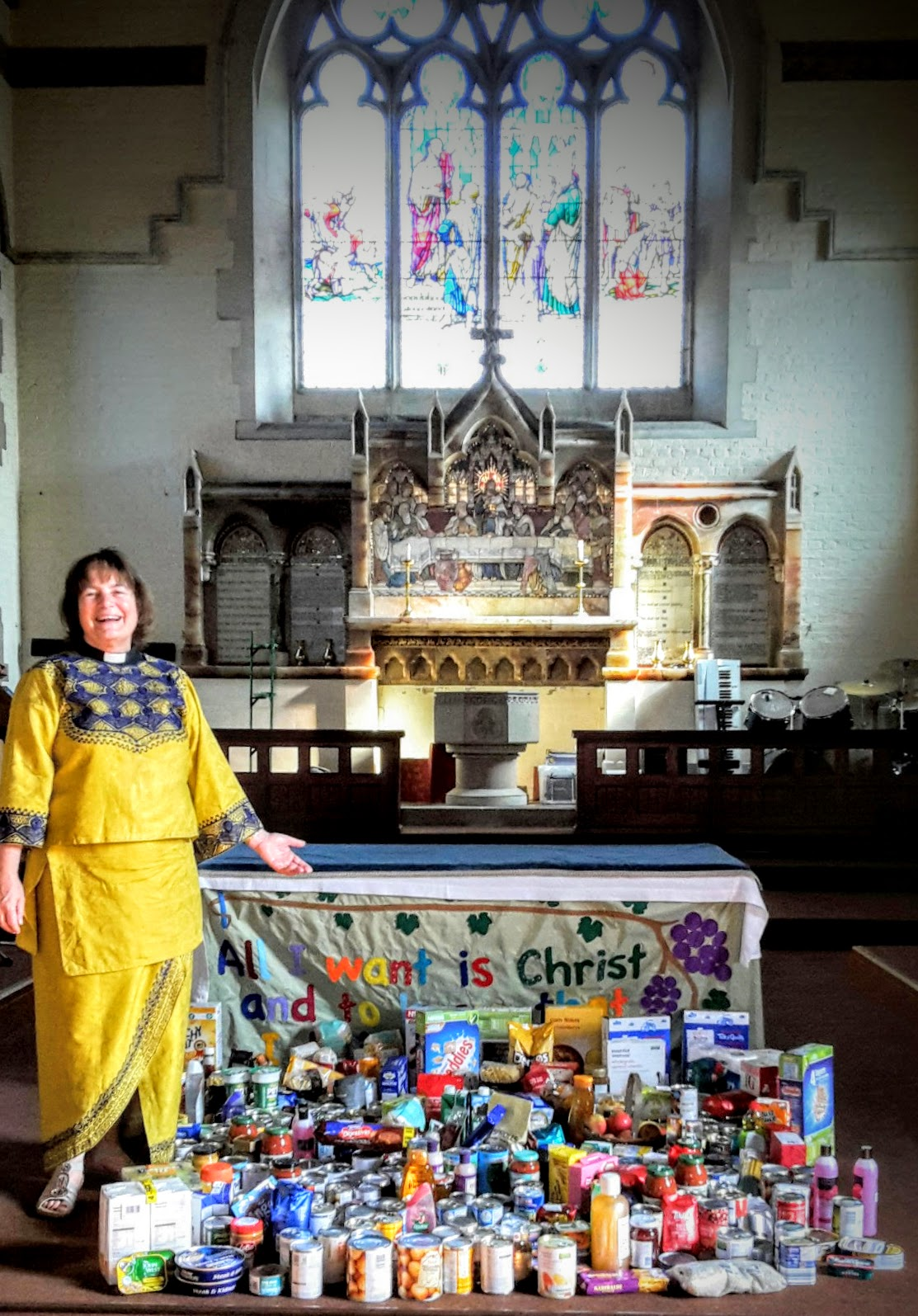 Revd Mavis Crispin, our associate rector, with the Harvest gifts.