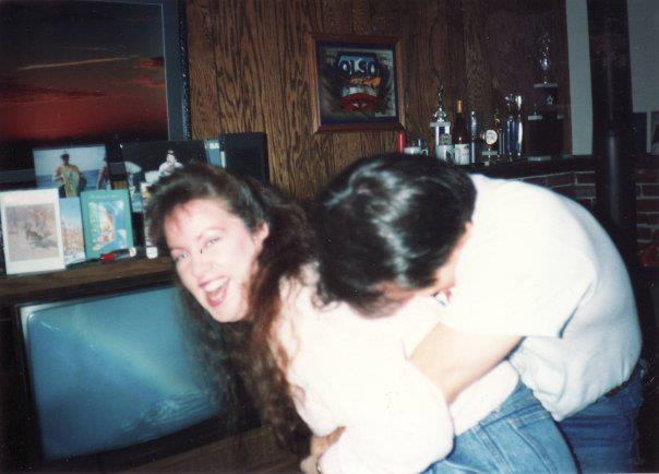 Again with my older brother. Probably the '90s. Clowning around at his home. It's blurry but so defines our relationship!