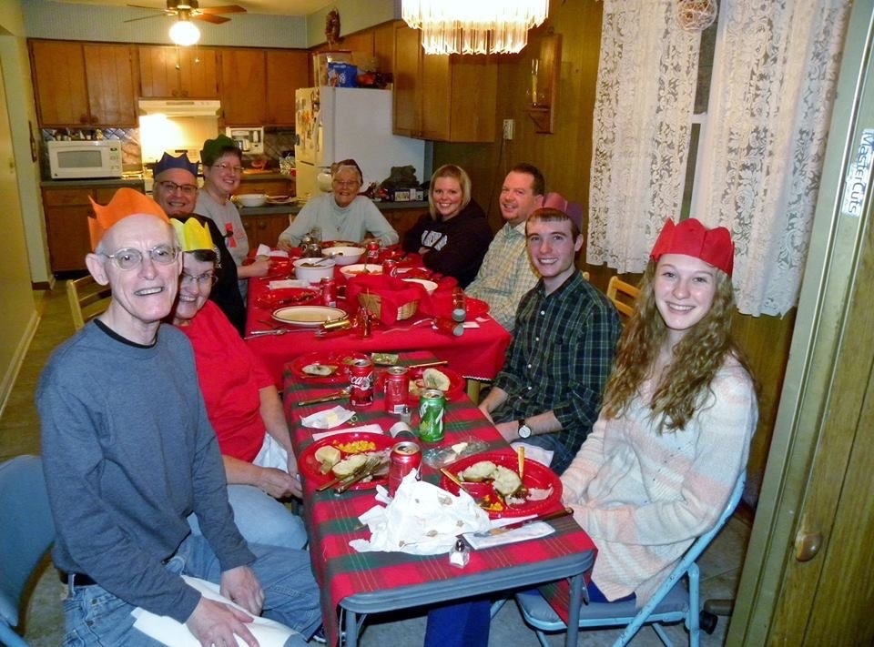 Our family, decades later! We wear our paper crowns at Christmas with pride.