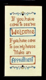 cross stitch sign