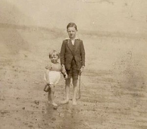 Here I am at the age of two with my big brother. It must have been a balmy day - probably as high as 60F/16C, because he is taking into the water to plodge.