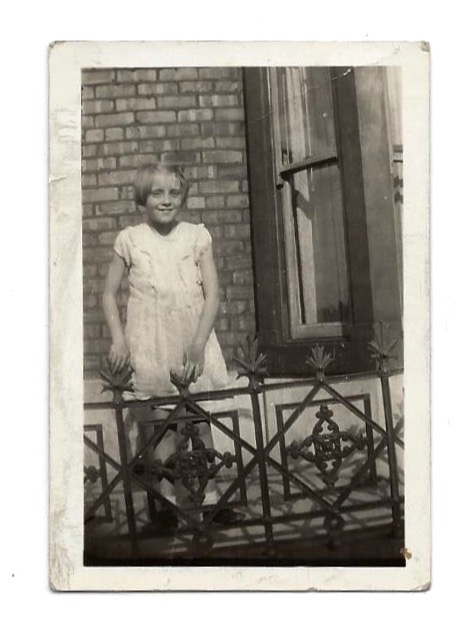 In front of my house at the age of eight.