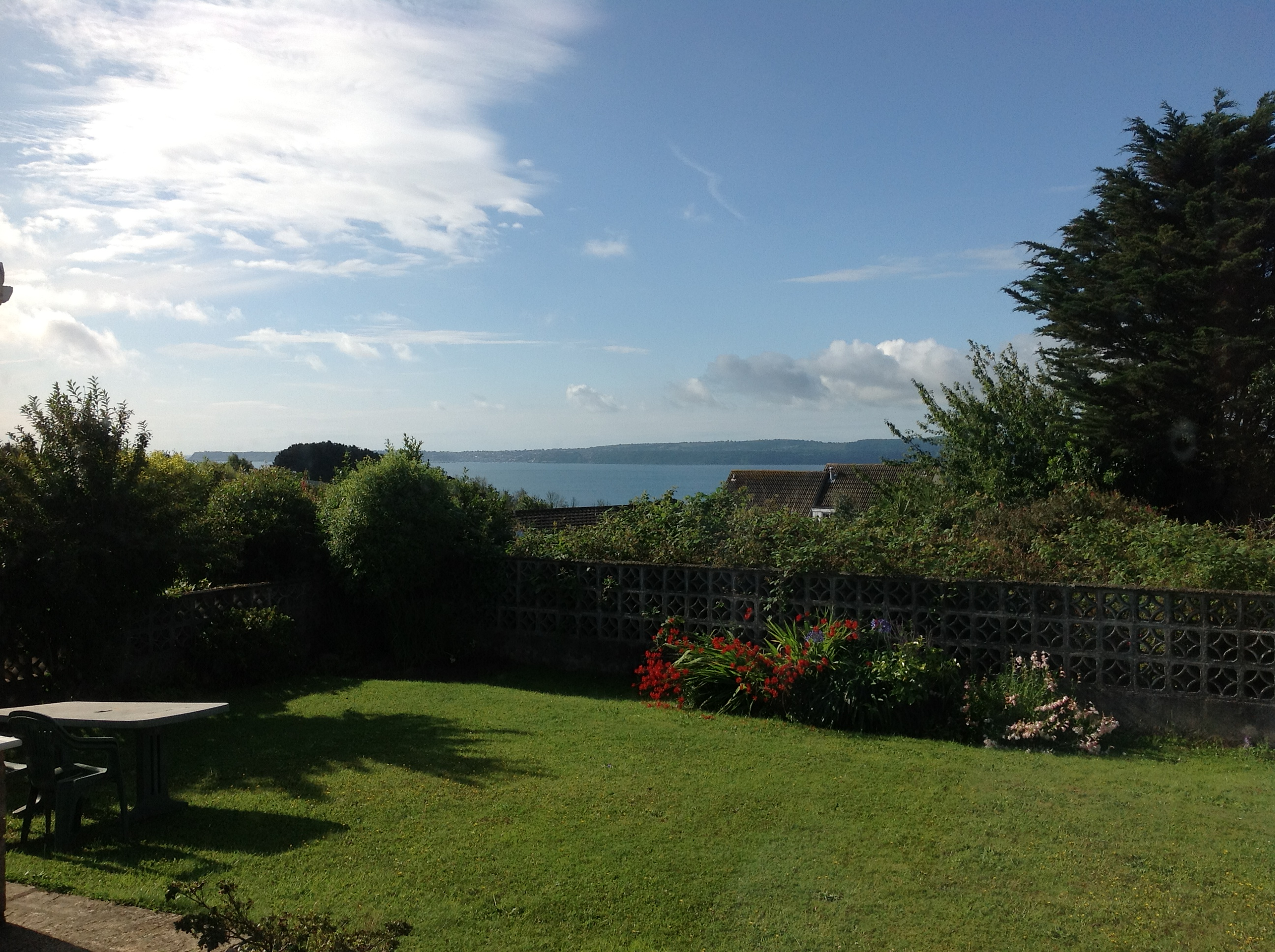 Our garden just after we moved in. The far side of the Bay (Torbay) is where Henry Francis Lyte wrote the hymn Abide with Me.