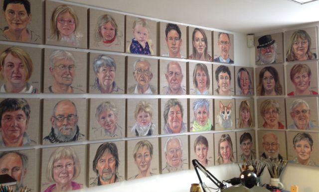Some of the accumulated portraits on the wall of my studio.