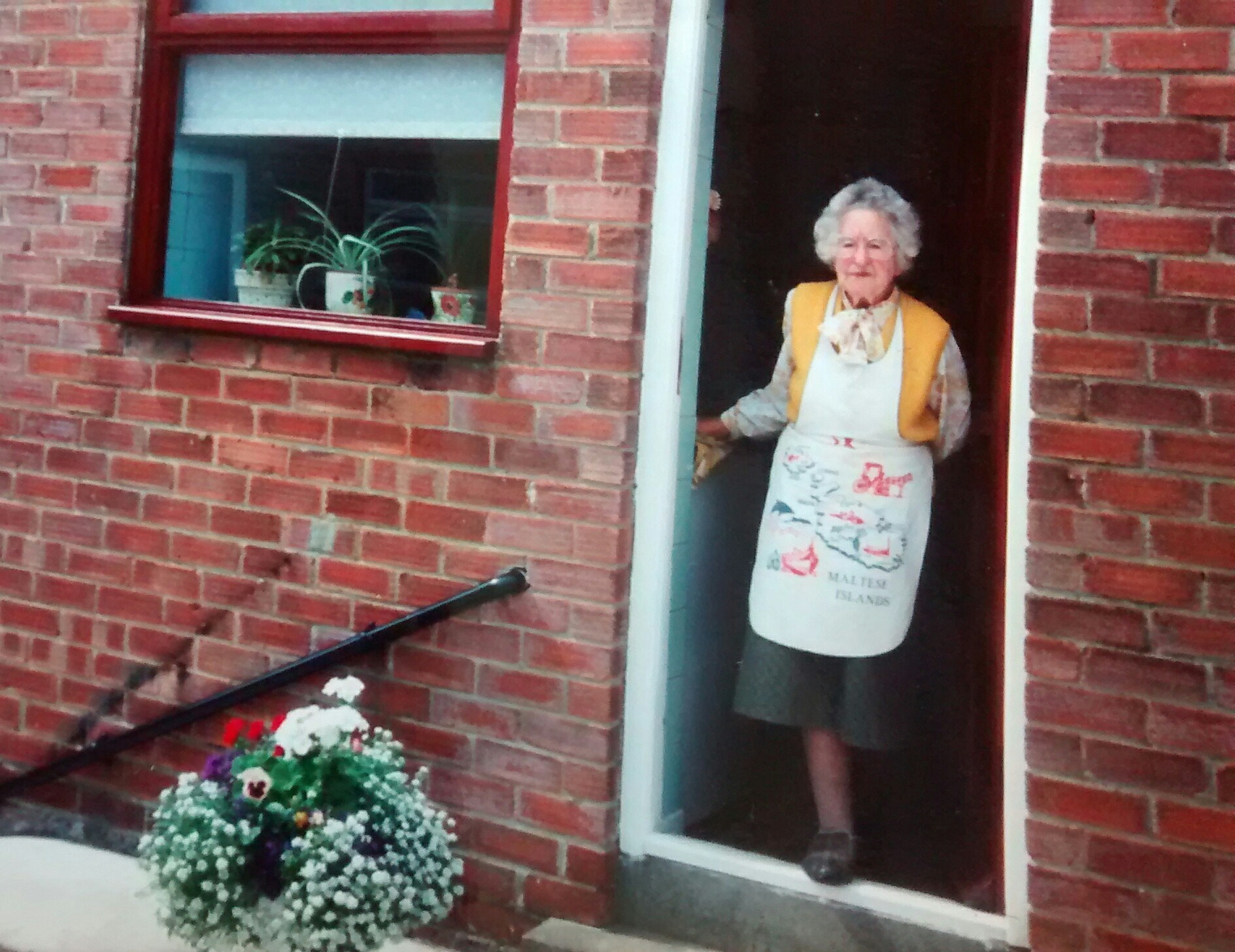 Grandma at her kitchen door. Yes, I'm crying now.