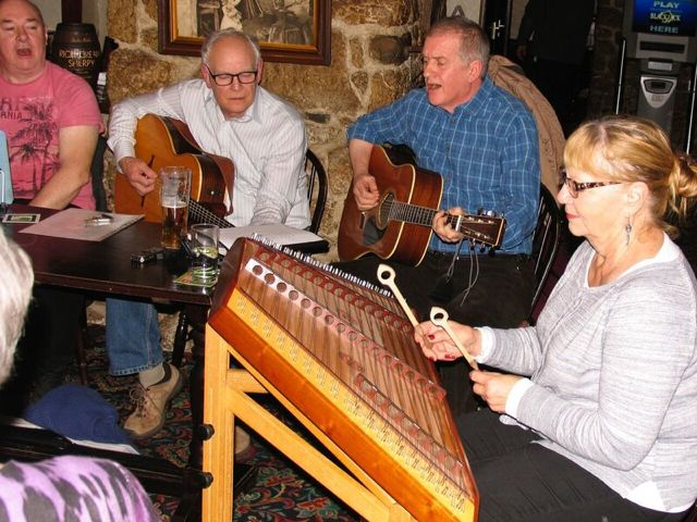Playing my dulcimer at the local pub with other local musicians: