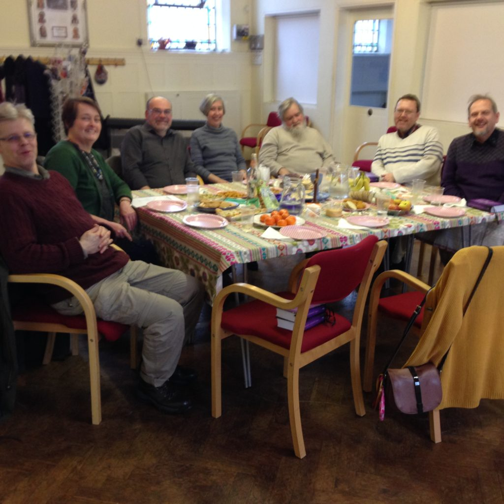 Mennonites eating together.