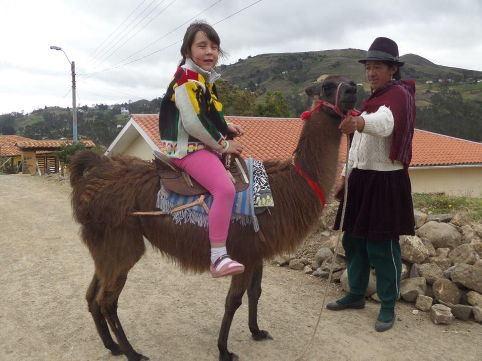 Riding a llama.