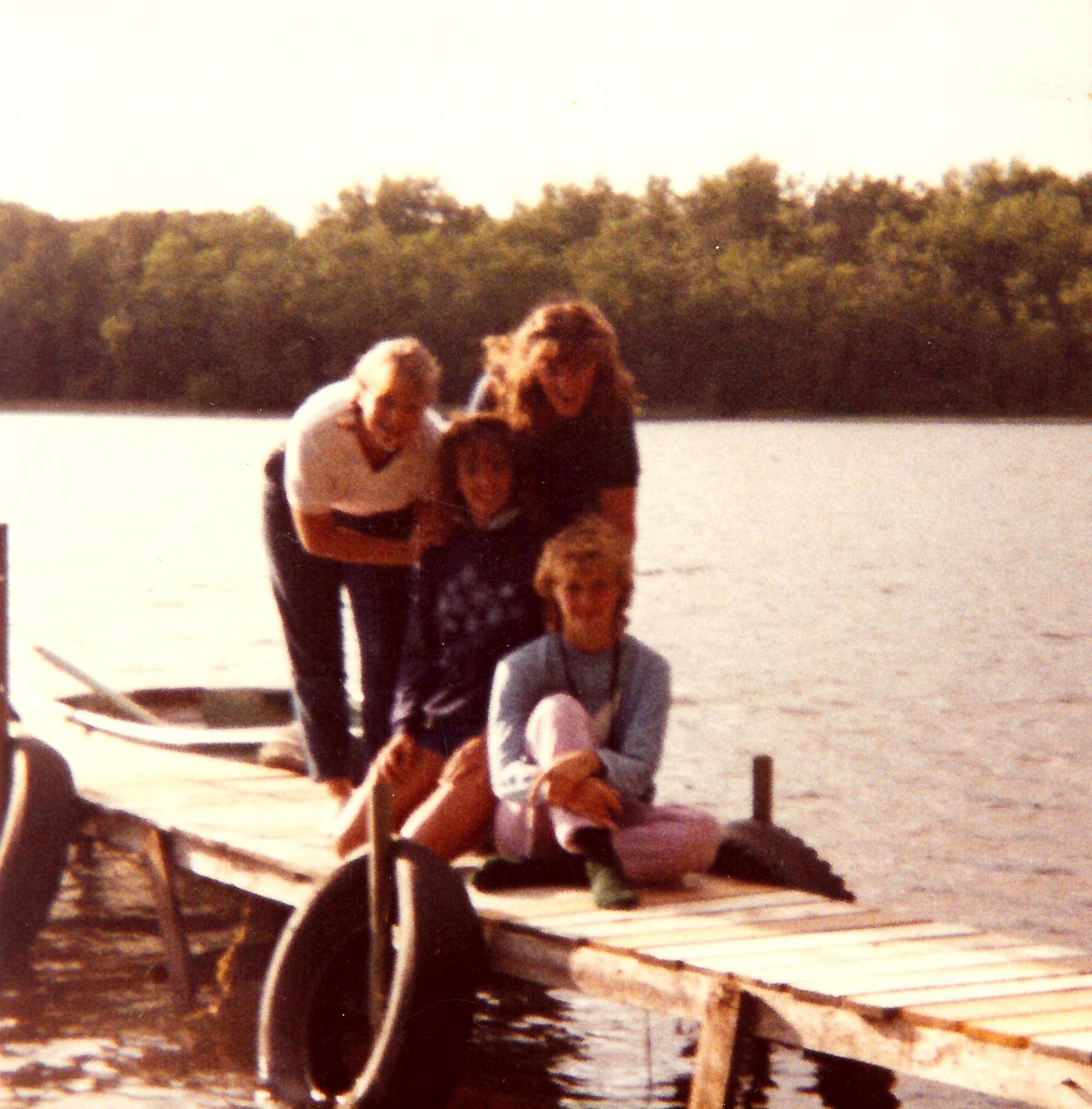 Some of the gang at Kara's cabin. Kara (R) and Sue (middle) sitting on the dock and Jill (L) and me (R) standing.